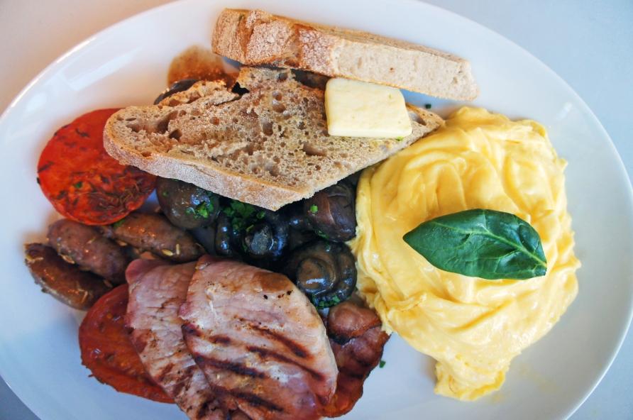 Full Aussie - scrambled eggs, sourdough toast, bacon, cumin roast tomato, miso chestnut mushrooms, chipolatas. Photo by Simon Wilder