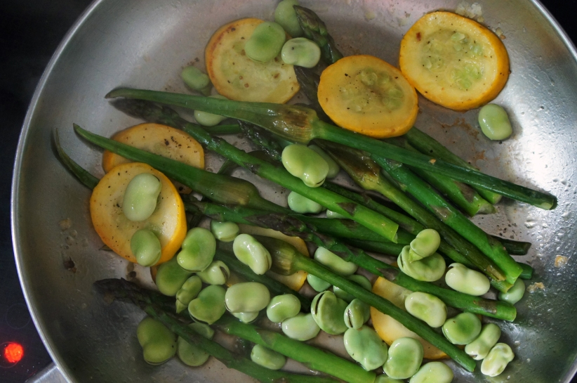 Scapes, asparagus, broad beans and yellow courgette. Photo by Simon Wilder