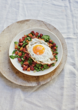 Sautéed peas with chorizo midges and golden fried egg