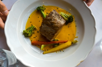 Tuna with carrot and ginger sauce. Photo by Simon Wilder
