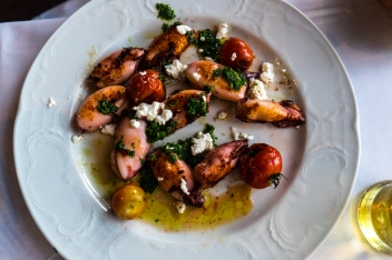 Calamari with tomatoes and feta. Photo by Simon Wilder