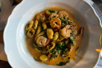 Shrimp with gnocchi, spinach and crab sauce. Photo by Simon Wilder