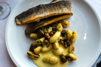 Sea bass with gnocchi, eggplant and cashew with lemon butter and coriander. Photo by Simon Wilder